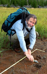 Jim Halfpenny measuring grizzly tracks