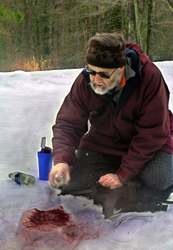 Jim Halfpenny casting grizzly track in snow