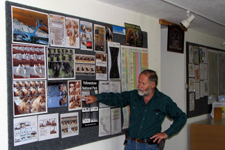 Jim Halfpenny at bear bulletin board in classroom